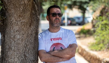 Ex-convict Yoni Yahav attends a demonstration to improve prisoners' conditions in front of the Knesset in Jerusalem, June 2020.