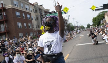 Demonstrators marching to defund the Minneapolis Police Department dance on University Avenue on June 6, 2020 in Minneapolis, Minnesota.