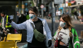 Israelis with masks in Tel Aviv, March 2020