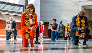 House Speaker Nancy Pelosi and other members of Congress kneel and observe a moment of silence in honor of George Flyod at the Capitol's Emancipation Hall, Washington, June 8, 2020.