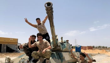 Fighters loyal to Libya's internationally recognized government celebrate after regaining control over the city, in Tripoli, Libya, June 4, 2020.