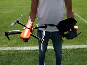 A test drone operator prepares to launch a drone during a demonstration of Eclipse at Bloomfield Stadium, in Tel Aviv, June 8, 2020.