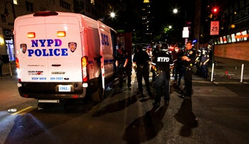 NYPD officers detain protesters for violating curfew during demonstrations over the killing of George Floyd, Manhattan, June 2, 2020.