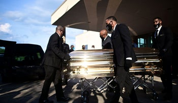 Pallbearers move the casket of George Floyd after a public viewing at the Fountain of Praise church in Houston, Texas, June 8, 2020.