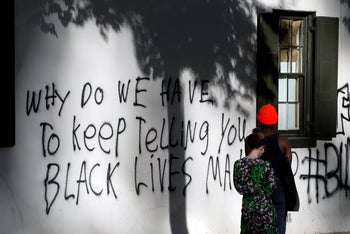 Graffiti on the side of the White House Historical Association building as demonstrators gather to protest the death of George Floyd, Washington, D.C., May 31, 2020.