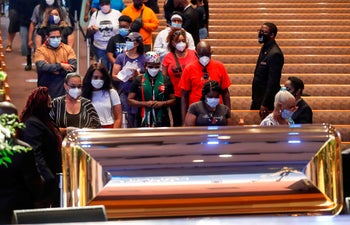 Mourners wait in line to pass by the casket of George Floyd during a public viewing at the Fountain of Praise church, Houston, June 8, 2020.