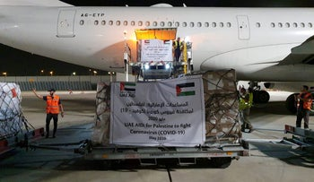 A cargo plane operated by Etihad Airways offloads aid related to the coronavirus disease (COVID-19) for Palestinians, at Ben Gurion Airport in Lod, near Tel Aviv, Israel May 19, 2020.