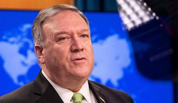 U.S. Secretary of State Mike Pompeo speaks to the press at the State Department in Washington, May 20, 2020.