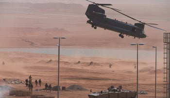 Boeing CH-47 Chinook takes off during an exercise at an Emirati military base home to a Military Operations in Urban Terrain facility in al-Hamra, UAE, March 23, 2020.