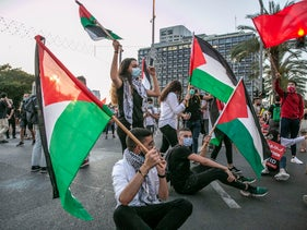 Protesters waving PLO flags at a protest against the annexation of parts of the West Bank, Tel Aviv, June 6, 2020