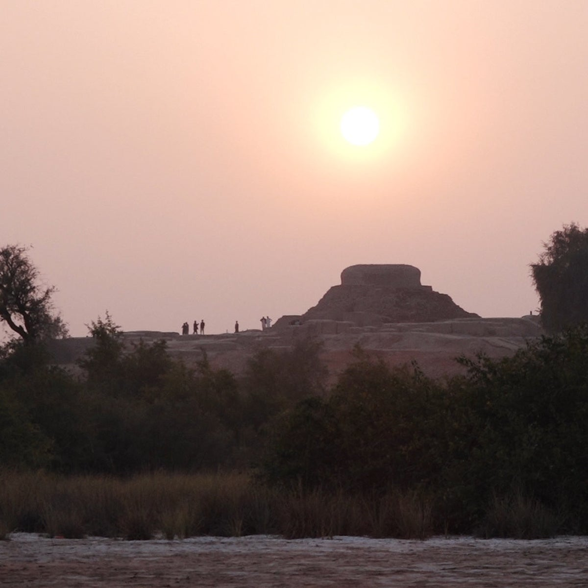 The sun sets over the stupa at Mohenjo Daro