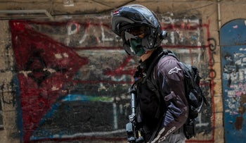 A police during an operation in Bnei Brak, June 11, 2020.