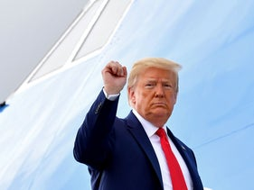 U.S. President Donald Trump pumps his fist as he boards Air Force One at Joint Base Andrews in Maryland, June 11, 2020.