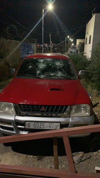 A Palestinian car vandalized in Hebron, the West Bank, June 13, 2020.