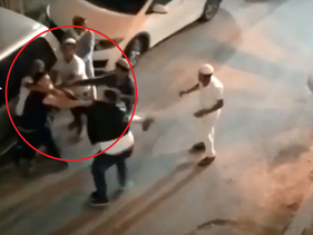 Screen grab from camera footage showing settlers attacking a Palestinian in Hebron, the West Bank.