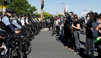 Demonstrators confront police officers on Lakeshore Drive during a Chicago March for Justice in honor of George Floyd, Saturday, June 13, 2020, in Chicago