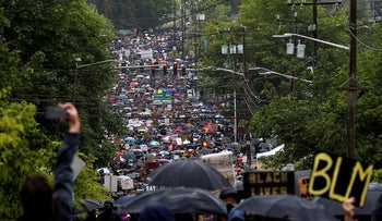 Tens of thousands of people walk up 23rd Avenue South as they participate in a silent protest march organized by Black Lives Matter Seattle-King County as people protest against racial inequality in the aftermath of the death in Minneapolis police custody of George Floyd in Seattle, Washington, U.S. June 12, 2020.