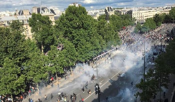 A general view shows French riot police forces firing tear gas during a rally as part of the 'Black Lives Matter' worldwide protests against racism and police brutality, on Place de la Republique in Paris on June 13, 2020