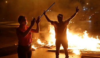 Anti-government protesters block a highway with burning tires and wood, in downtown Beirut, Lebanon, June 11, 2020.