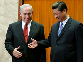 Israel's Prime Minister Benjamin Netanyahu, left, prepares to shake hands with China's President Xi Jinping at the Great Hall of the People in Beijing. May 9, 2013
