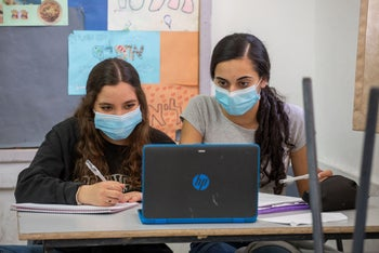 Students study while wearing face masks at Ziv High School in Jerusalem, June 4, 2020