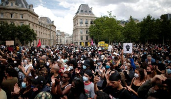Demonstrators attend a protest against police brutality and the death in Minneapolis police custody of George Floyd, at the Place de la Republique square in Paris, France, June 13, 2020.
