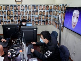 Software engineers for the electronics company Hanwang Technology work on a facial recognition program that identifies people when they wear a face mask, Beijing, China, March 6, 2020.