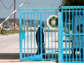 A Palestinian Health Ministry officer stands at the gate of the Erez crossing with Israel, March 2020.