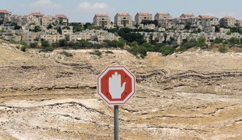 A traffic sign in front of the Israeli settlement of Maale Adumim in the Israeli-occupied West Bank. June 15, 2020