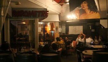 People sit together at Barometre bar in Beirut, Lebanon, June 5, 2020.