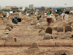 Members of a forensic team work in a cemetery where a mass grave of conscripts killed in 1998, in the Sahafa neighbourhood, south of the Sudanese capital Khartoum, June 13, 2020.