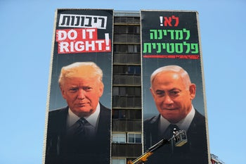 "A banner depicts President Donald Trump and Prime Minister Benjamin Netanyahu, stating ""No to a Palestinian State"" and ""Sovereignty Do it right!"", Jerusalem, June 10, 2020"