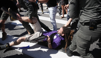 "A protester is dragged away by police officers during a ""demonstration of fury"" protest, Jerusalem, June 15, 2020."