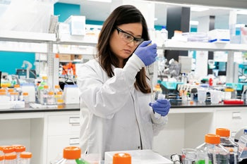 File photo: An Assistant is seen conducting research for a coronavirus vaccine in a laboratory in San Diego, California, March 17, 2020.