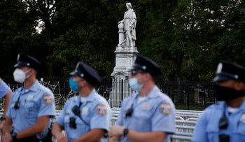 Philadelphia police officers gather near the statue of Christopher Columbus at Marconi Plaza, June 15, 2020.