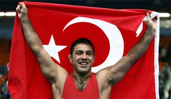 Hamza Yerlikaya of Turkey celebrates after winning the gold medal in the greco-roman wrestling 96kg division in the European Wrestling Championships in Moscow, April 27, 2006.