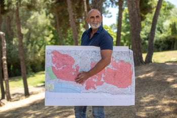 David Elhayani, head of the Yesha Council of settlements, holding a map of the West Bank.