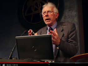 Screenshot of Kevin MacDonald giving a lecture on the 'Psychological Mechanism of White Dispossession' hosted by Logik Förlag, a far right publisher in Sweden. April 2015