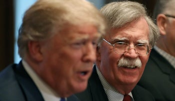 Then National Security Advisor John Bolton (R), listens to U.S. President Donald Trump in the Cabinet Room, Washington, DC., April 9, 2018.