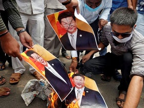 Supporters of India's ruling Bharatiya Jayanta Party (BJP) burn defaced posters of Chinese President Xi Jinping during a protest against China, in Ahmedabad, India, June 17, 2020