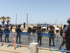 Jaffa residents protesting the construction of a homeless shelter on a Muslim burial ground as security forces surround the area, June 17, 2020.