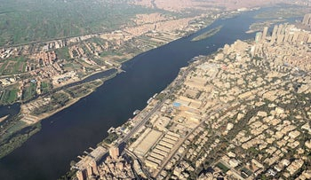 A view from an airplane window shows buildings around the Nile River in Cairo, Egypt March 10, 2020.