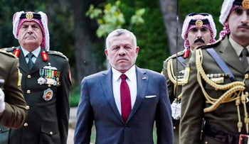 Jordanian King Abdullah II (C) walking with an honor guard, Amman, Jordan, May 25, 2020.