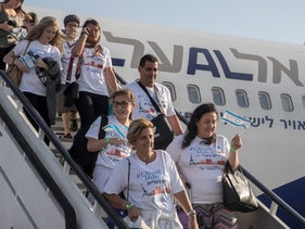 Newly arrived immigrants from France disembark a plane upon their arrival at the Ben Gurion International Airport near Tel Aviv on July 10, 2017.