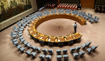 File photo: An official looks at the empty chairs of leaders ahead of their participation in an open debate of the United Nations Security Council in New York, September 20, 2017.
