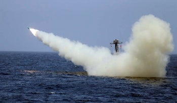 An Iranian warship launches a missile during a naval exercise, on June 18, 2020.