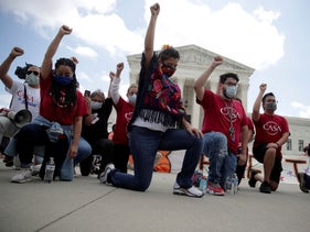 People take a knee in support of the Black Lives Matter movement outside the U.S. Supreme Court in Washington, U.S., June 18, 2020.
