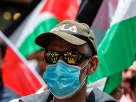 A demonstrator clad in sunglasses and mask at protest against annexation in the West Bank city of Nablus, June 3, 2020.