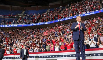 U.S. President Donald Trump reacts to the crowd as he arrives onstage at his first re-election campaign rally in several months in the midst of the coronavirus disease (COVID-19) outbreak, at the BOK Center in Tulsa, Oklahoma, U.S., June 20, 2020