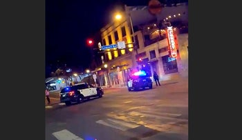 Police vehicles block the road after a shooting in Minneapolis, Minnesota, U.S. June 21, 2020, in this picture obtained from social media video